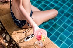 Beautiful Woman with cocktail glass near swimming pool Stock Photos