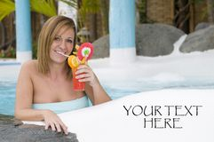 Beautiful woman with cocktail in a swimming pool Stock Photography