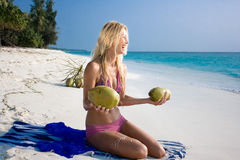Beautiful woman with coconut. On white sand tropical beach Stock Photos