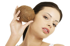 Beautiful woman with coconut in hands Stock Image