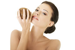 Beautiful woman with coconut in hands Stock Photos