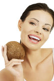 Beautiful woman with coconut in hands Royalty Free Stock Photography