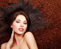 Beautiful  woman with coffee beans Stock Images