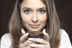 Beautiful woman with coffee beans Royalty Free Stock Photos