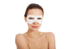 Beautiful woman with collagen mask on eyes. Stock Images