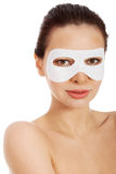 Beautiful woman with collagen mask on eyes. Royalty Free Stock Photos