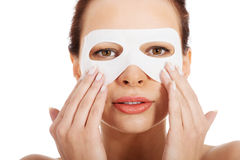 Beautiful woman with collagen mask on eyes. Stock Photo