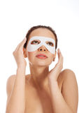 Beautiful woman with collagen mask on eyes. Royalty Free Stock Image