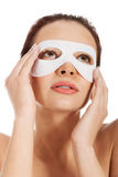 Beautiful woman with collagen mask on eyes. Stock Photography