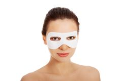 Beautiful woman with collagen mask. Stock Image