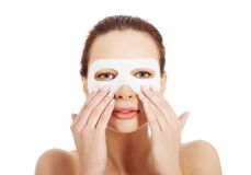Beautiful woman with collagen mask. Stock Photos