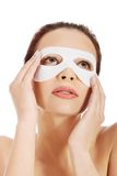 Beautiful woman with collagen mask. Royalty Free Stock Photo