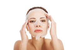 Beautiful woman with collagen mask. Royalty Free Stock Images