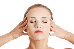 Beautiful woman with collagen mask. Stock Photography