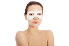 Beautiful woman with collagen mask. Royalty Free Stock Photography