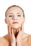 Beautiful woman with collagen mask. Stock Images