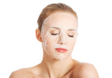 Beautiful woman with collagen mask on face. Stock Photos