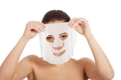 Beautiful woman with collagen mask. Stock Photo