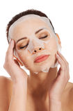 Beautiful woman with collagen mask. Royalty Free Stock Photos