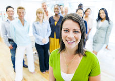Beautiful woman with colleagues Royalty Free Stock Images