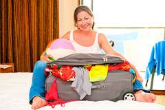 Beautiful woman and collected a suitcase Stock Image