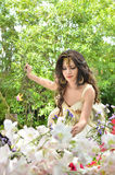 Beautiful woman collecting flower in flower garden Royalty Free Stock Image