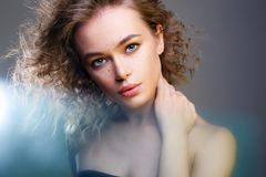 Beautiful woman in color Lights. amazing curly girl stock photography