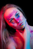 Beautiful woman with color powder on face Royalty Free Stock Images