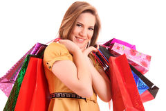 Beautiful woman with color shopping bags Royalty Free Stock Photos