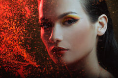 Beautiful woman in color spray Royalty Free Stock Images