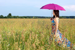 Beautiful woman with color umbrella Royalty Free Stock Image