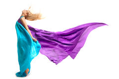 Beautiful woman in colored fabric. Isolated Royalty Free Stock Images