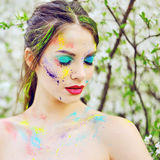Beautiful woman with colored paint on face outdoor Royalty Free Stock Image