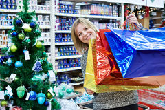 Beautiful woman with colorful bag in supermarket Royalty Free Stock Image