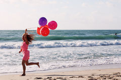 Beautiful woman with colorful balloons Stock Photos