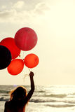 Beautiful woman with colorful balloons Royalty Free Stock Photo