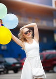 Beautiful woman with colorful balloons in summer holidays Stock Photography