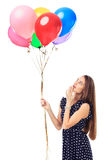 Beautiful woman with colorful balloons Stock Image