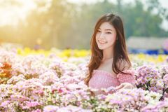 Beautiful woman in chrysanthemum glower garden Royalty Free Stock Photo