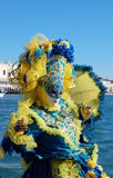 Beautiful woman in colorful costume and mask, Piazza San Marco Stock Photography