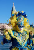 Beautiful woman in colorful costume and mask, Piazza San Marco Stock Images