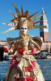 Beautiful woman in colorful costume and mask, Piazza San Marco Royalty Free Stock Photos