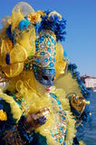 Beautiful woman in colorful costume and mask, Piazza San Marco Royalty Free Stock Images