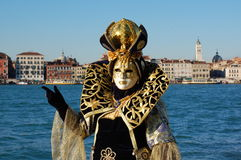 Beautiful woman in colorful costume and mask, view on Piazza San Marco Royalty Free Stock Photography