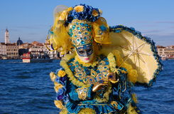 Beautiful woman in colorful costume and mask, view on Piazza San Marco Stock Image