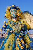 Beautiful woman in colorful costume and mask, view on Piazza San Marco Stock Photo