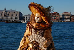 Beautiful woman in colorful costume and mask, view on Piazza San Marco Stock Images