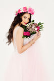Beautiful Woman with Colorful Flower Arrangement Royalty Free Stock Photography