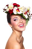 Beautiful woman with colorful flowers on head Stock Photos