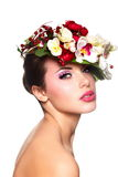 Beautiful woman with colorful flowers on head Royalty Free Stock Images
